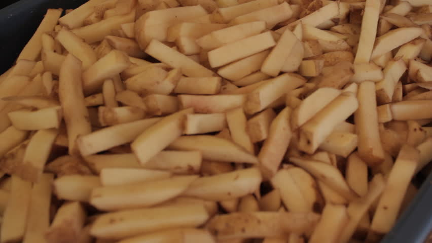 Fresh Cut French Fries Before Being Cooked. - HD stock footage clip