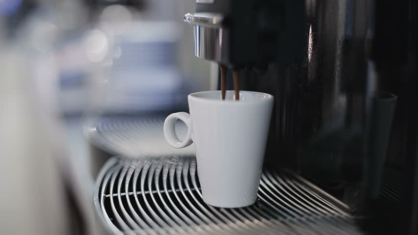 Automatic coffee machine is pouring coffee - HD stock footage clip