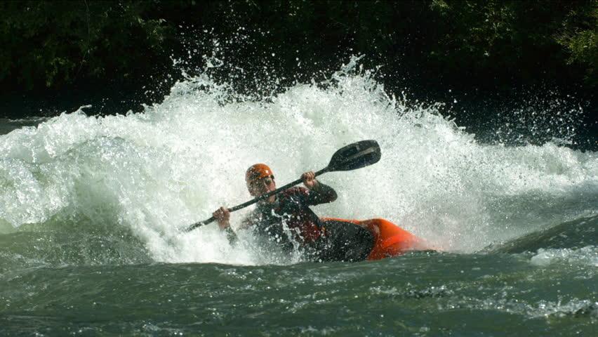 Cinemagraph - Kayaking in white water. Looping Motion Photo.