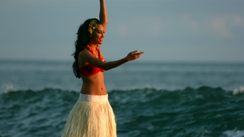 Cinemagraph - Hula dancer performs by ocean waves, slow motion. Looping Motion Photo.