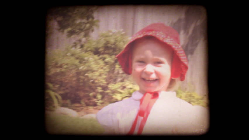 Old home movie of a family in their back yard with a vintage 8mm film look. Shot with my family recently, but very authentic looking. Includes projector audio.