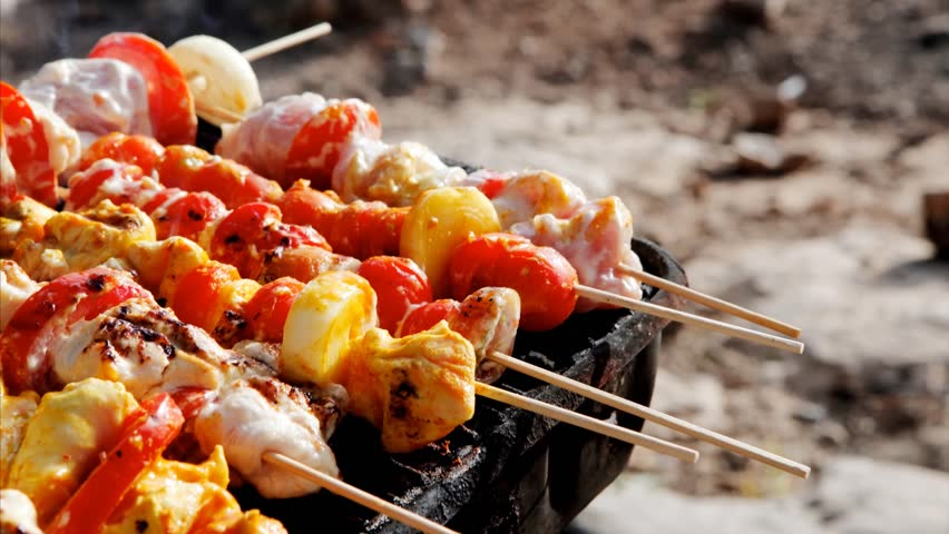 chicken shish kebab on bbq grill in sauce on skewers with tomatoes and peppers 1920x1080 intro motion slow hidef hd