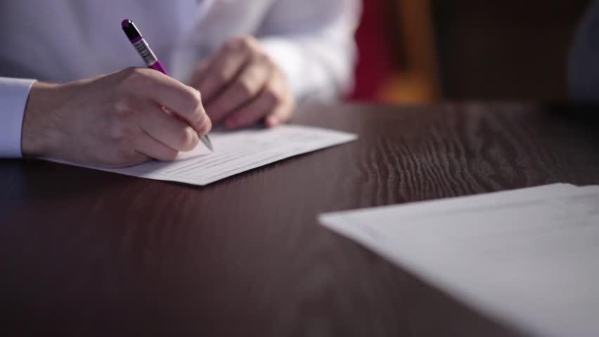 A man is writing description - medium shot