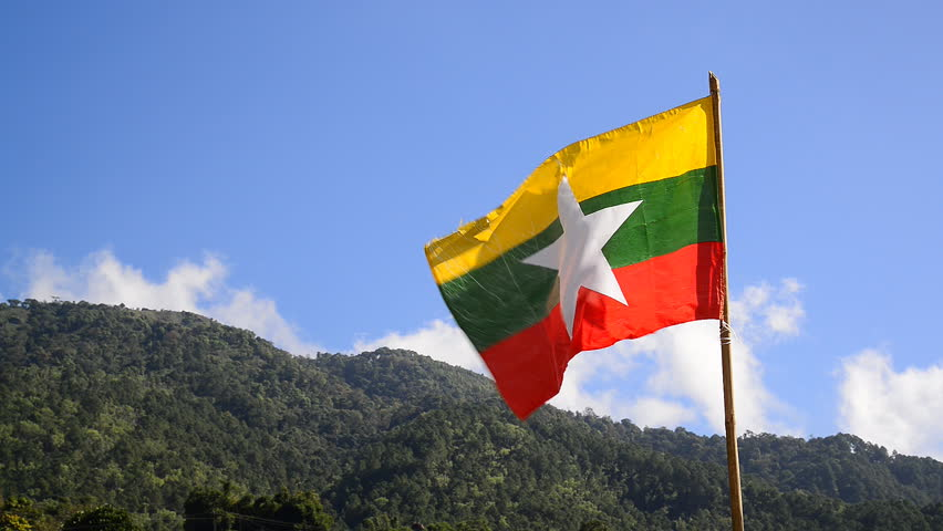 Flag of Myanmar (Burma) waving on hill