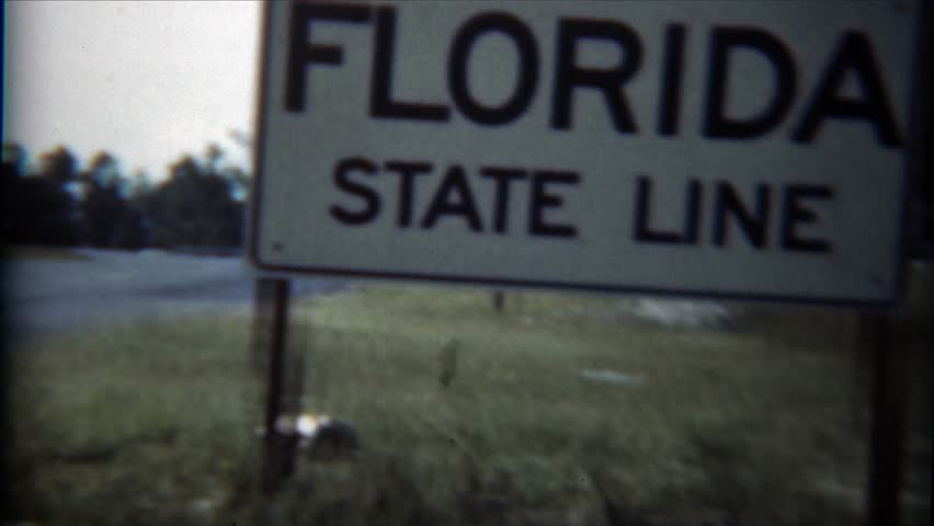 JACKSONVILLE, FLORIDA 1954: Florida state line black classic car parked documented. - 4K stock footage clip