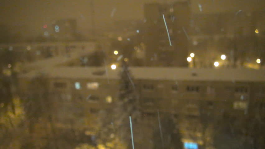 Snowing in Night, Aerial Snow Fall Christmas Scene, Winter View in Town District - HD stock video clip