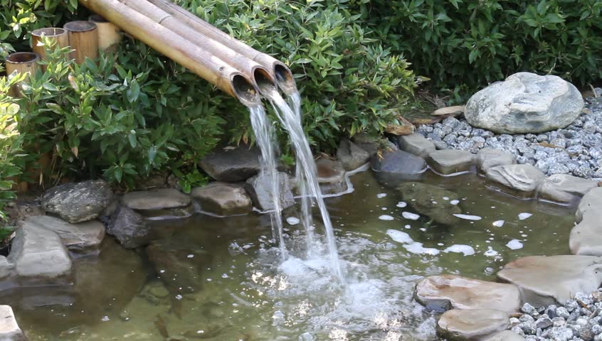 Bamboo fountain in a zen garden hd stock video clip for Zen garden waterfall