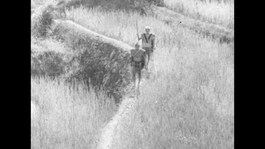 ASIA 1960s: Men Walk through the Ifugao village, Asia