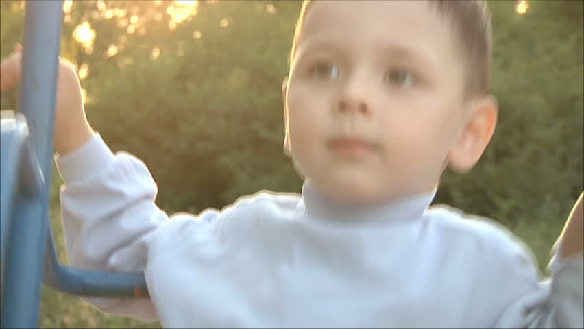 little boy riding on a swing 3 - HD stock footage clip