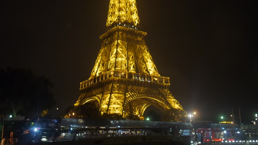 Paris, France - October, 2015 - Tour Eiffel at night shot from a boat at night.