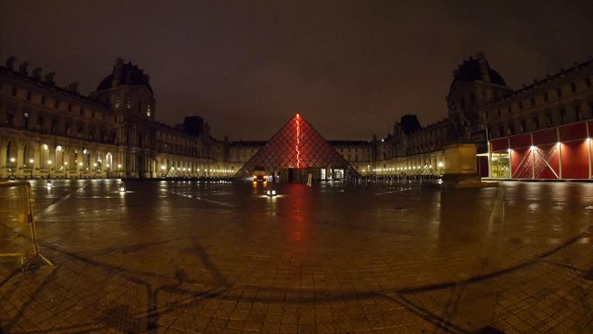 Paris, France - October, 2015 - Wide shot of the Pryamide du Louvre at night.