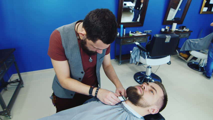 barbershop the wizard cut machine close up men 39 s haircut in a barbershop stylish close up. Black Bedroom Furniture Sets. Home Design Ideas