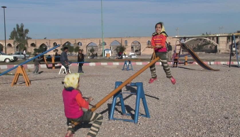 IRAN - CIRCA 2010: Children play on a see-saw circa 2010 in Iran. - HD stock footage clip