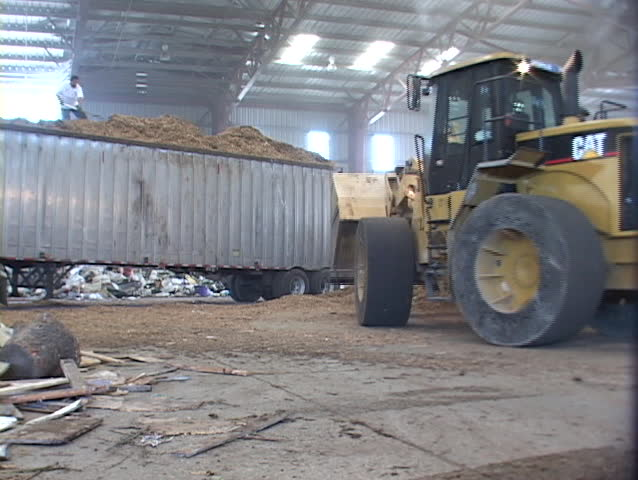 SANTA BARBARA, CA - CIRCA 2009: A loader moves piles of recyclable materials in a recycling center circa 2009 in Santa Barbara, Ca.