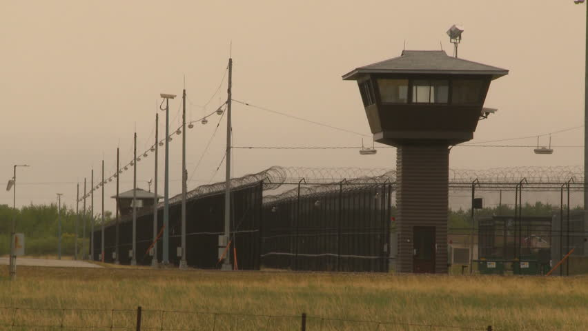 prison fence and towers