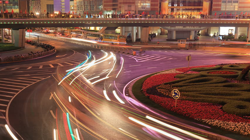 Cityscape timelapse at night. traffic through downtown in Shanghai, China. - HD stock video clip