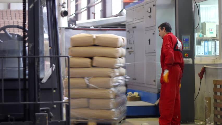 Worker packs bags of sugar - HD stock video clip