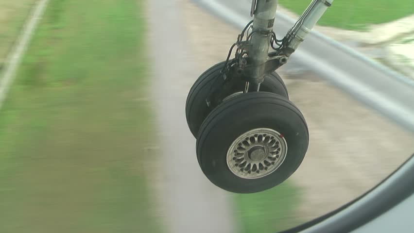 Landing: the airplane goes to airfield,  undercarriage close-up   (HD video,  23 sec)
