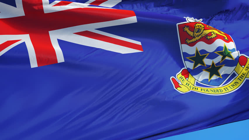 Cayman Islands flag waving in slow motion against blue sky, seamlessly looped, close up, isolated on alpha channel with black and white luminance matte, perfect for film, news, digital composition