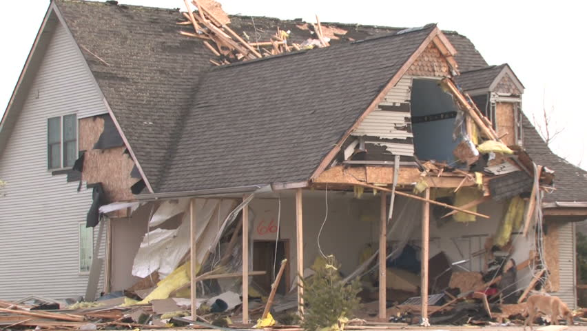 Zooming out from a house that has been destroyed by a tornado.