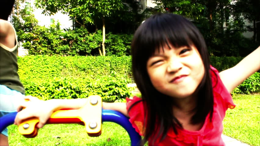 Asian girl playing at a playground - HD stock video clip