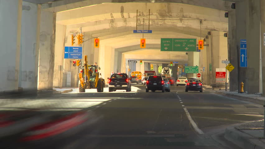 TORONTO, CANADA - OCTOBER 24, 2010: time-lapse traffic under expressway on October 24, 2010 in Toronto, Canada - HD stock video clip