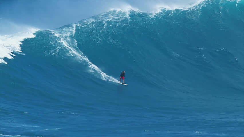 "MAUI, HI - MARCH 13: Professional surfer Yuri Soledade rides a giant wave at the legendary big wave surf break known as ""Jaws"" during one the largest swells of the winter March 13, 2011 in Maui, HI."