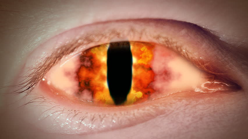 Close up to devil's fire eyeball. Loop.