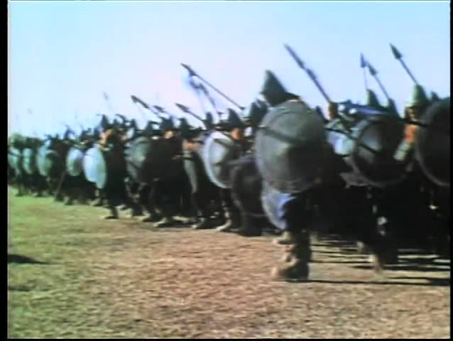 Wide shot medieval soldiers on the attack