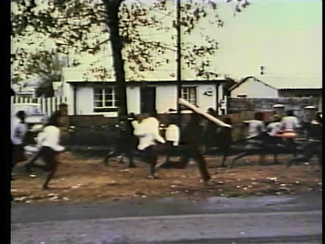 South African children running on sidewalk
