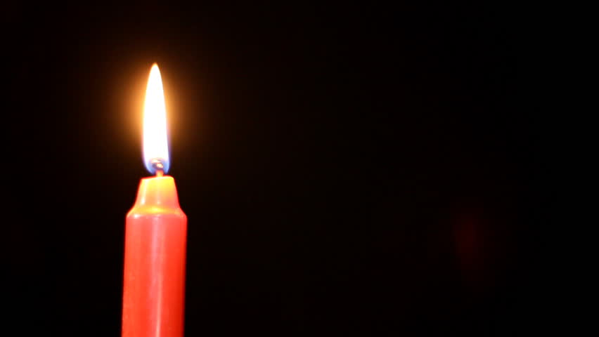 Candle is lighted on black - HD stock footage clip