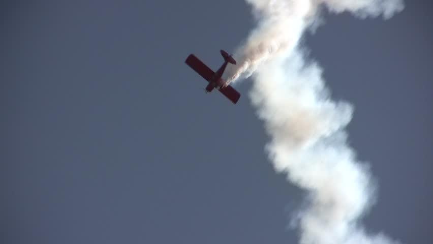 STUART, FL - NOVEMBER 12: Skilled pilot shows amazing aerial stunts during the annual airshow in Stuart, Florida on November 12, 2011.