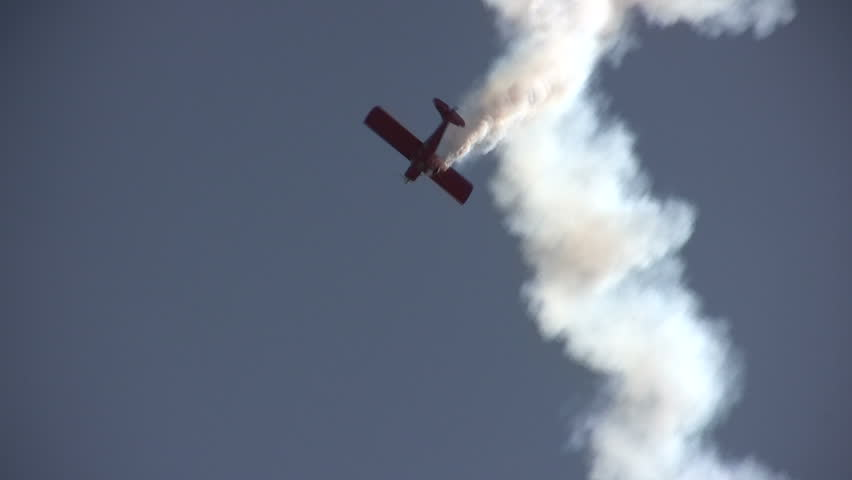 STUART, FL - NOVEMBER 12: Skilled pilot shows amazing aerial stunts during the annual airshow in Stuart, Florida on November 12, 2011.
