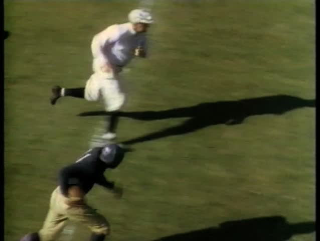College football player heading for touchdown