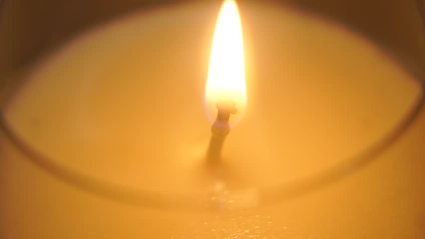 Large candle lights up and burns