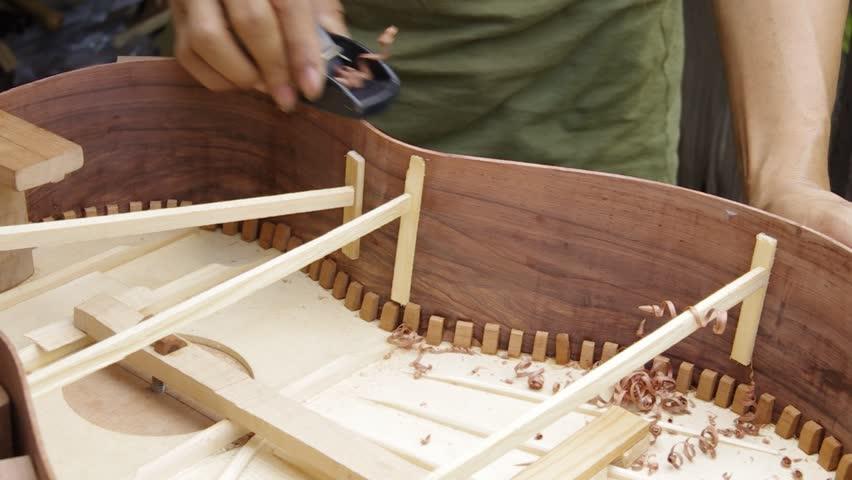 making guitar,shape side - HD stock video clip