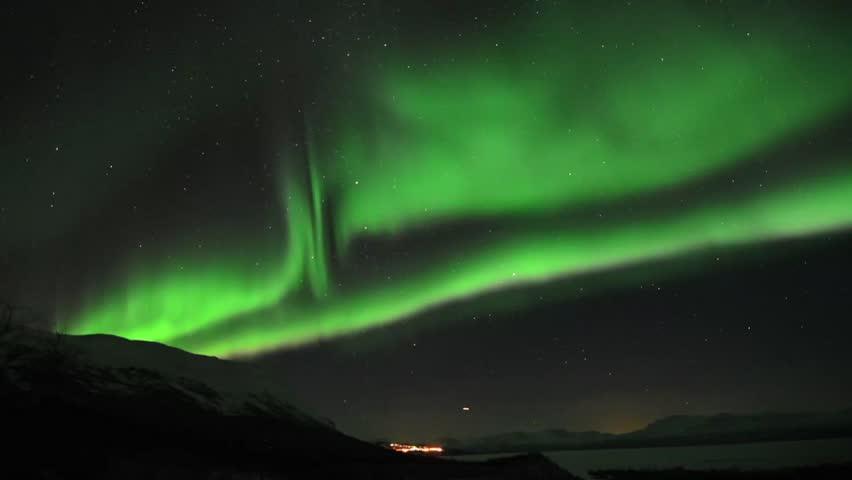 Aurora borealis over an arctic mountain