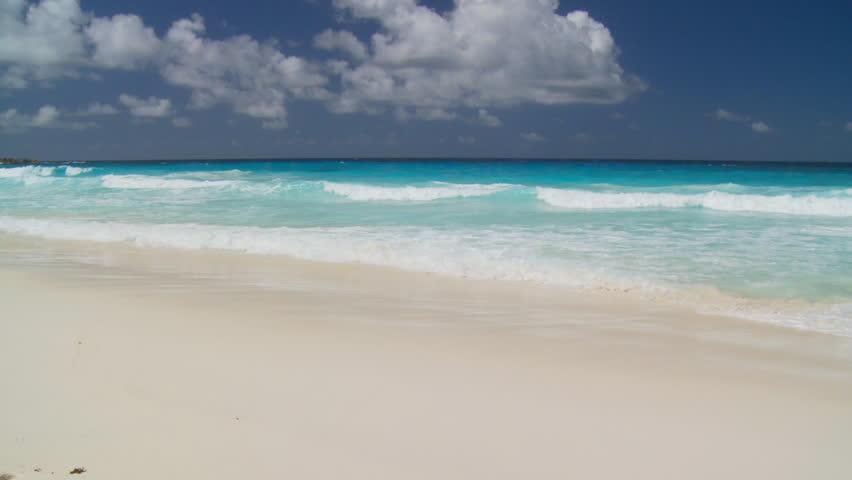 waves landing on sandy beach