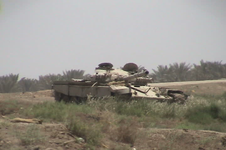 BAGHDAD, IRAQ - CIRCA 5/16/03: Destroyed Iraqi tanks along roadside.
