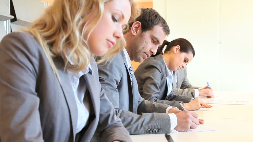 Young business people signing contract - HD stock footage clip