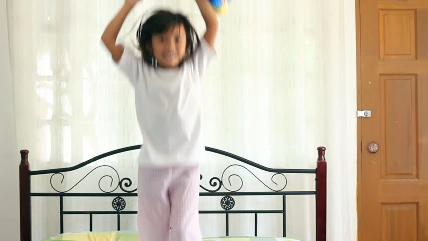 Happy child jumping on bed. - HD stock video clip