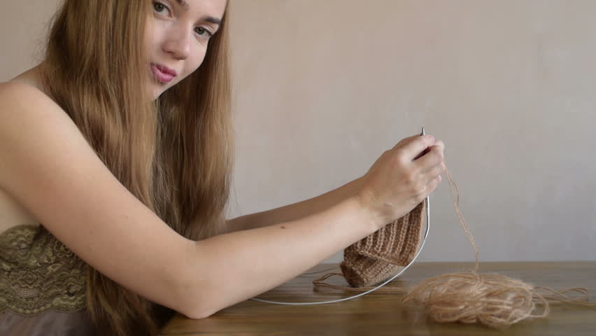 Woman with long hair knitting