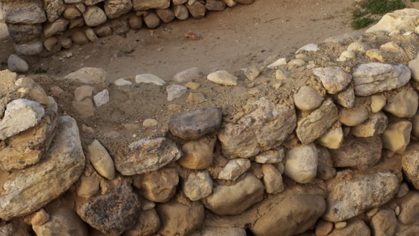 An ancient wall at Tel Be'er Sheva shot in Israel. - HD stock footage clip