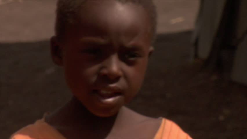 KENYA - CIRCA 2006: Unidentified little boy talks towards the camera circa 2006 in Kenya.