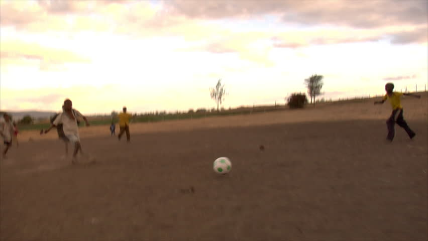 KENYA - CIRCA 2006: Unidentified kids run and play soccer circa 2006 in Kenya.