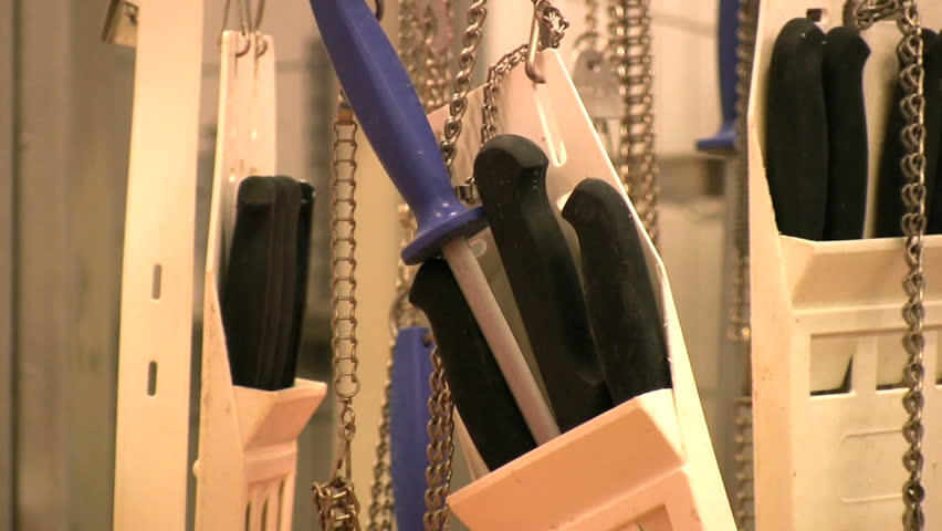 Knifes hanging on a rack in a slaughterhouse