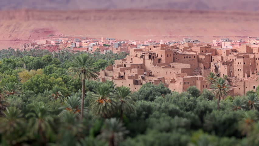 Panorama of a village in Moroccan hills, Morocco, thousand Kasbah road. Oasis in Sahara desert area. Tilt-shift effect.