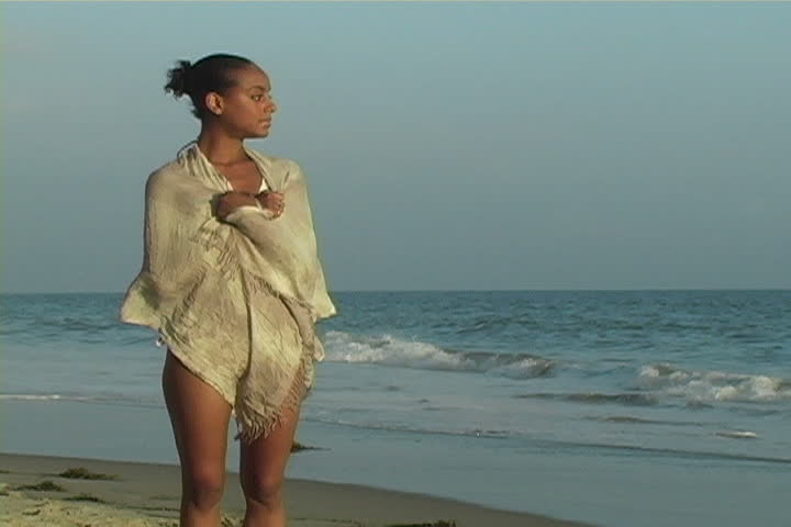 A beautiful women at the beach.  - SD stock video clip