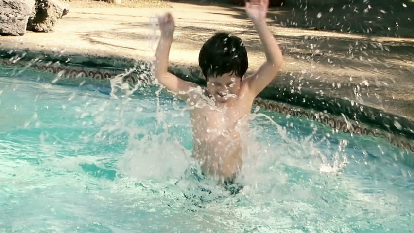 Kid Tantrum in Water Slow Motion (HD). Kid splashing with arms in shallow pool water; Hispanic origin; six years old. Slow motion captured at 60p and conformed to 30p.