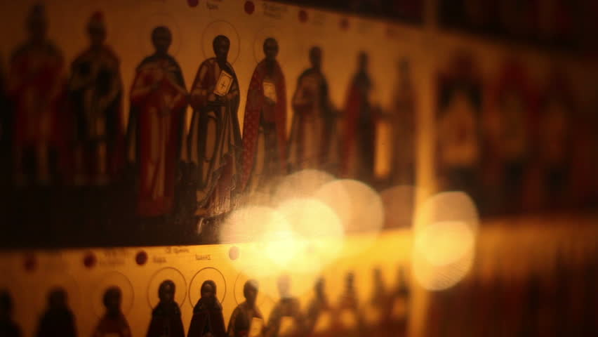 MOSCOW - JANUARY 14: Icons of saints and candles inside the church at the Savvinskiy Monastery on January 14, 2012 in Moscow, Russia.